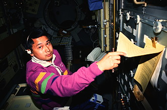 Trinh onboard Space Shuttle