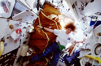 Helms onboard Space Shuttle