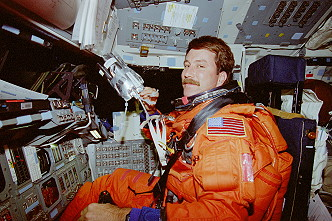 Rominger onboard Space Shuttle